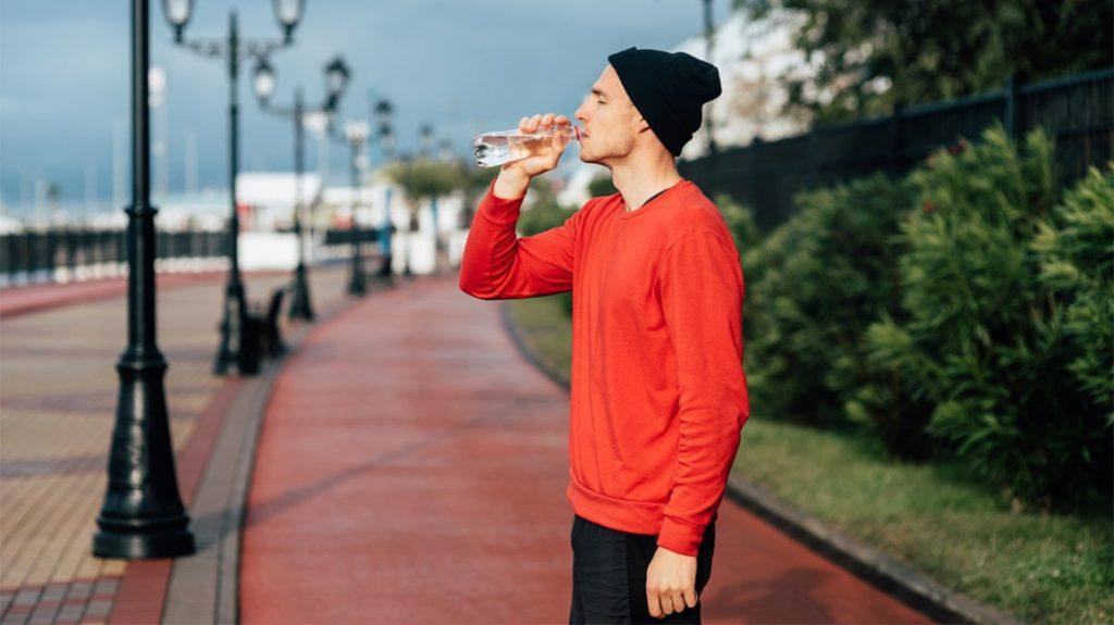 man-running-drinking-water-exercising-outdoors-1296x728-header